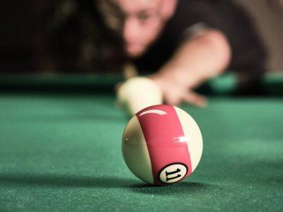 Pool player lining up shot
