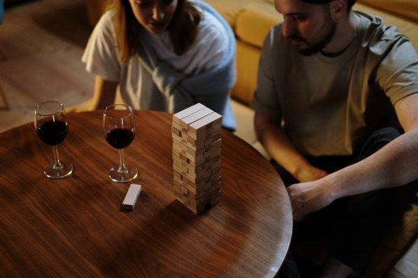 Couple playing Jinga at table