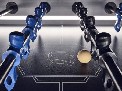 Blue and black foosball strikers