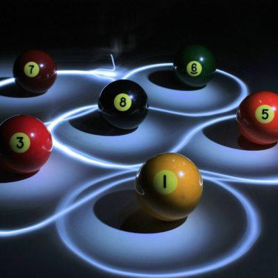 Pool balls lit up on table