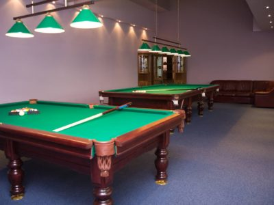 Large billiard room with two tables and bar