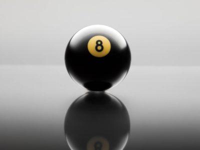 studio shot of billiards ball number 8 on gray background