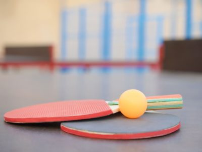 rackets and ball close up on Ping pong table in outdoor sport yard.