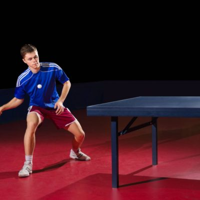 Professional table tennis player returning shot
