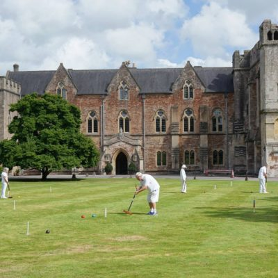 Playing croquet in front of a castle