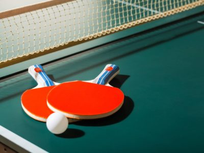 Ping pong paddles, ball, net, and table