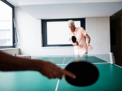 Senior playing ping pong in the retirement house