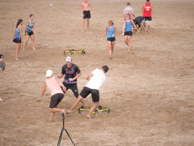 Playing spikeball on the beach