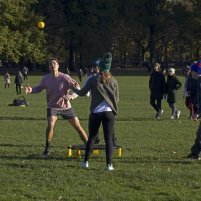 Group of Friends Play Spikeball in a Park