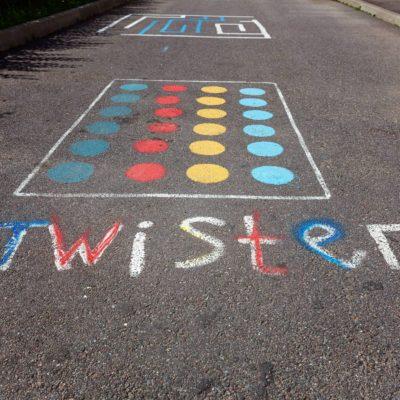 children's game twister on the asphalt