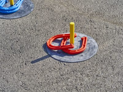 Horse shoes game in the asphalt