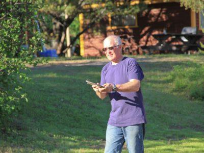 Senior man playing horseshoes